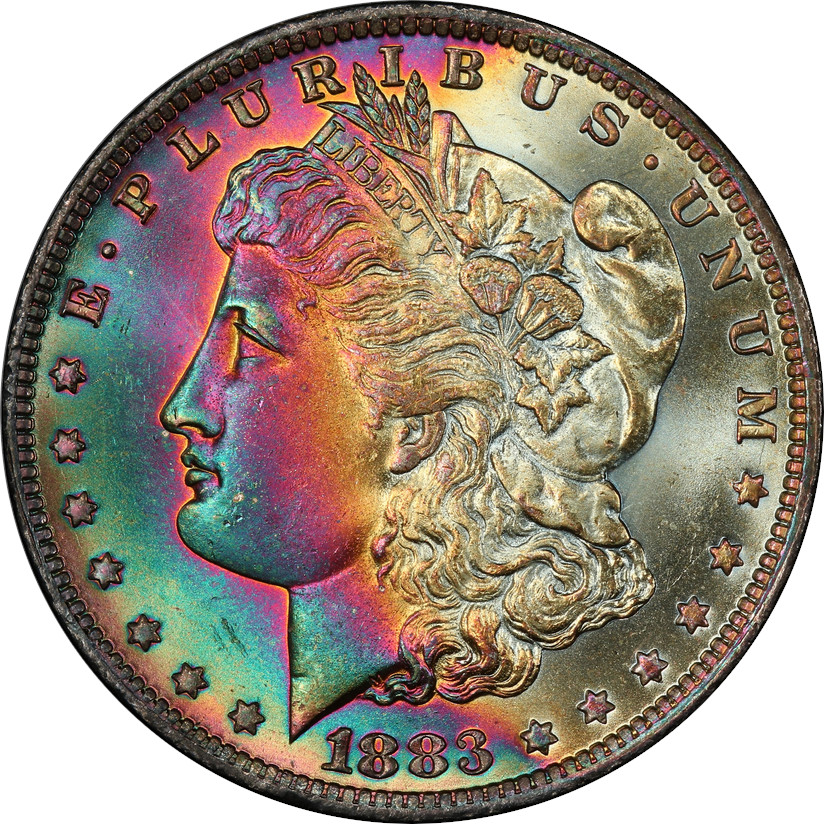 Now this is a commercially viable toning! It's beautiful and vibrant and shows of the luster in the coin's strike. We feel this coin is very appealing to most collectors, so we rate is 7/10.